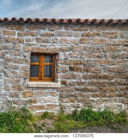 door and window in a rustic wall in Sardinia Italy