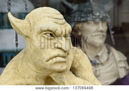 Closeup of carved gargoyle statue with big ears