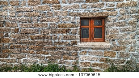 close up of a small window in a rustic wall