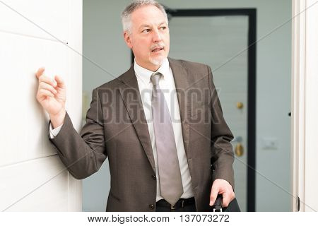 Businessman knocking on the door