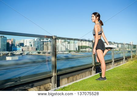 Woman stretching legs at outdoor