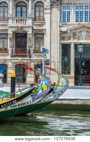 Aveiro Portugal - June 22 2016. Typical Moliceiro boat in the canals of Aveiro. Portugal.