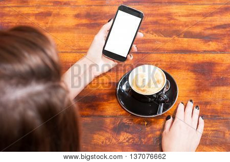 Woman Holding Smartphone On Terrace With Coffee