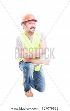 Portrait Of Cheerful Worker Kneeling And Doing Thumbup