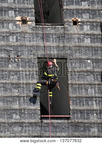Brave Climber Of Firefighters Rappelling The Wall