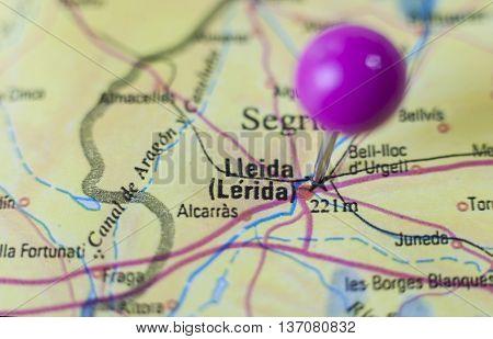 Pushpin marking on Lleida Spain. Selective focus on city
