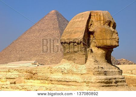 GIZA, EGYPT - DECEMBER 24: A Sphinx in Giza on DECEMBER 24, 2014. The Great Sphinx with the Pyramid of Keops in Giza, Egypt.