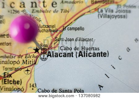 Pushpin marking on Alicante Spain. Selective focus on city
