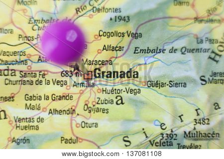 Pushpin marking on Granada Spain. Selective focus on city