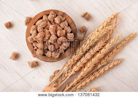 Top view of wheat bran and wheat ears