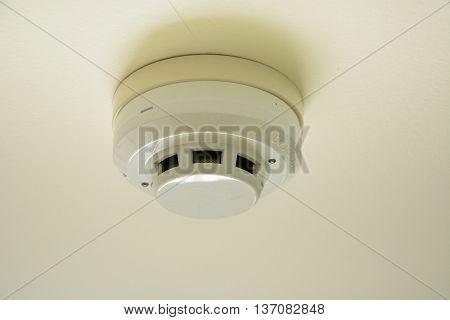 a fire smoke sensor on house ceiling