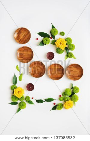Wooden Dishes With Wreath Frame From Roses.