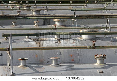 Pipeline Pipes And Safety Valve Above The Gigantic Pressure Vess