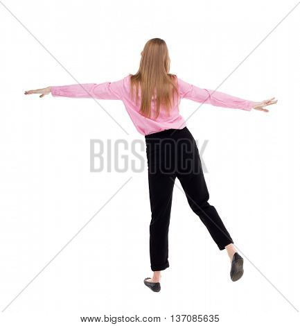 Balancing young business woman.  or dodge falling woman. Rear view people collection.  backside view of person. Isolated over white background. girl office worker in black pants balances on left leg