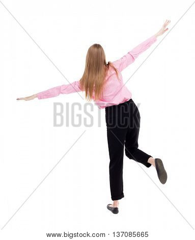 Balancing young business woman.  or dodge falling woman. Rear view people collection.  backside view of person. Isolated over white background. girl office worker in black pants balances on right foot