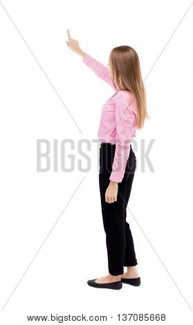 Back view of  pointing woman. beautiful girl. Rear view people collection.  backside view of person.  Isolated over white background. Long-haired girl in a red shirt is standing sideways.