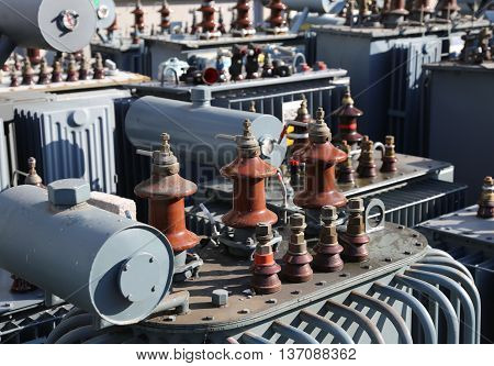 Many Old Large Electric Voltage Transformers In The Dump Of The