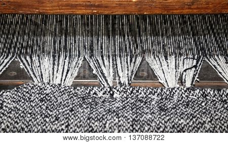Ancient Textile Loom Of Wood With Black And White Color Woolen T