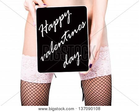 technology, internet and networking - close-up ass of girl in lacy lingerie, holding a tablet pc happy valentines day sign. Adult content, young woman holding aq gift.