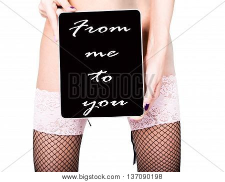 technology, internet and networking - close-up ass of girl in lacy lingerie, holding a tablet pc from me to you sign. Adult content, young woman holding aq gift.