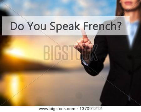 Do You Speak French ? - Businesswoman Pressing High Tech  Modern Button On A Virtual Background
