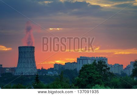 Steam from thermal station pipe at dawn with copyspace