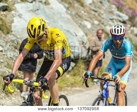 Col de la Croix de Fer France - 25 July 2015: The British cyclist Christopher Froome of Team Sky and the Ialtian cyclist Vincenzo Nibali of Team Astana climbing to the Col de la Croix de Fer in Alps during the stage 20 of Le Tour de France 2015.