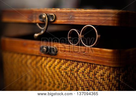 gold wedding rings on an old wood chest