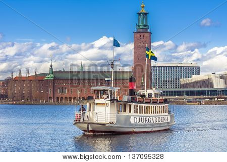 Stockholm, Sweden - March 30, 2016 Stockholm city old town. Ship sailing and transporting tourists on Gamla Stan the old town of Stockholm cityy