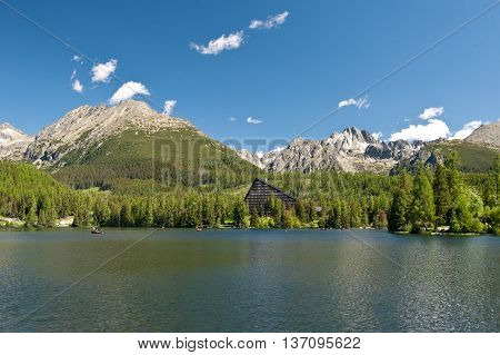Strbske pleso in High tatras in summer. High tatras mountains. Vysoke tatry. Slovakia. Nature of Slovakia. Hotel Patria. Lake. Mountains. Forest.
