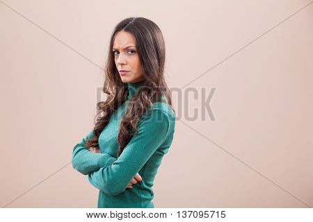 Studio shot portrait of displeased and angry woman.