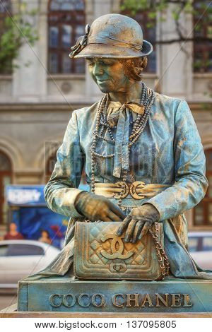 Bucharest, Romania - June 10, 2016: Coco Chanel living statue at B-FIT in the Street. B-FIT is a cultural event that involves international artists and acrobats who act in theater plays on street.