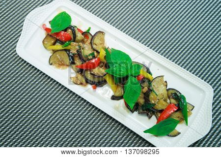 Vegetarian food Thai Style Eggplant Stir-Fry with Bean paste and chillli Thai basil.