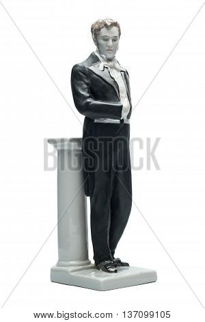 Gentleman. Old figurine man in tailcoat. Three-quarter view isolated on the white background.