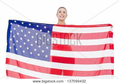 Female athlete holding American flag on white background