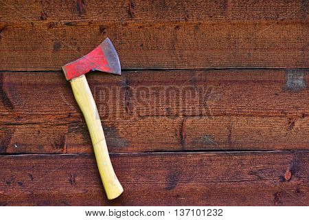 red axe on the red wood wall