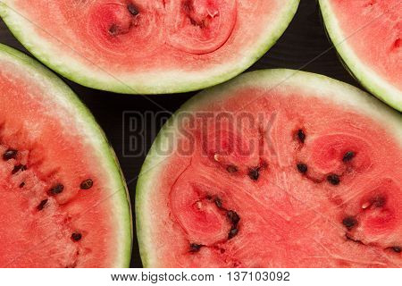 watermelon pieces on the brown wooden table