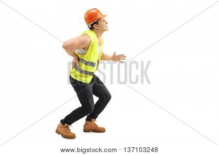 Male construction worker experiencing severe back pain isolated on white background