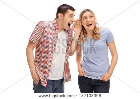 Man whispering something to his female friend and both laughing isolated on white background