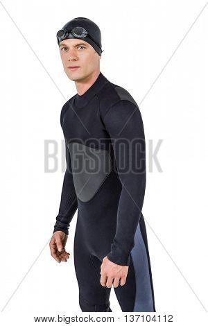 Portrait of confident swimmer in wetsuit on white background
