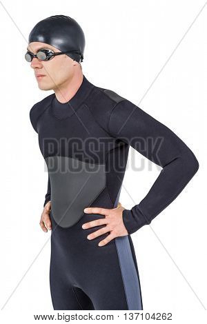 Confident swimmer in wetsuit posing on white background