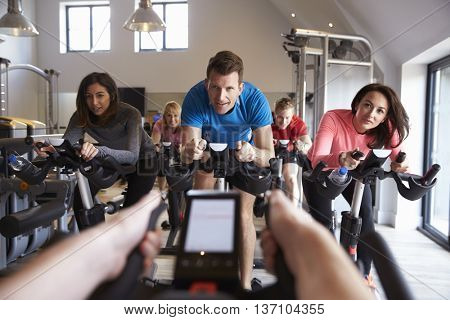Instructorâ??s POV of spinning class at a gym