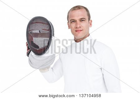 Portrait of swordsman holding fencing mask on white background