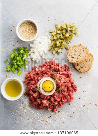 Beef tartare with bread minced onions and cucumbers
