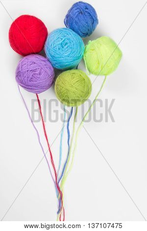 Colored Woolen A Thread On A White Background In The Form Of Balloons