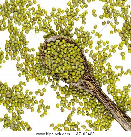 mung beans in and out wood spoon isolated on white background