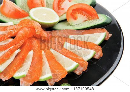 fresh smoked salmon served on black plate