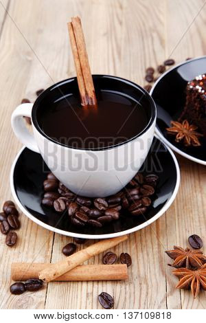 sweet food : hot black fragrant coffee and chocolate cake with cinnamon sticks, coffee beans, and anise star