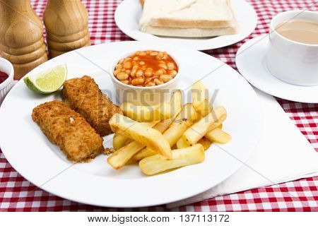 Fish fingers Traditional British children's meal of fish finger chips and beans