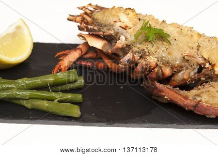 Lobster Thermidor Half a Lobster Thermidor with New Potatoes and Asparagus Spears